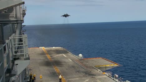 The-Harrier-Jet-Aircraft-Fighter-Lands-On-The-Deck-Of-An-Aircraft-Carrier