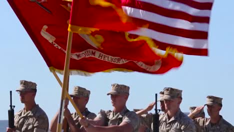 Marine-Corps-Troops-Salute-In-A-Ceremony-On-A-Runway-At-An-Airbase