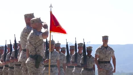 Marine-Corps-Troops-Salute-In-A-Ceremony-On-A-Runway-At-An-Airbase-1