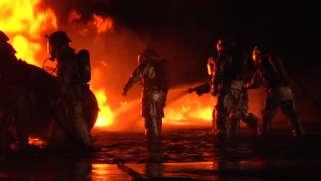 Firemen-In-Hazmat-Or-Heat-Resistant-Suits-Fight-An-Intense-Fire-At-Night-2