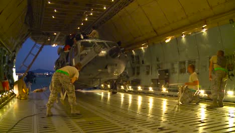 An-Hh60-Pavehawk-Helicopter-Is-Loaded-Onto-A-C5-Galaxy-Transport-Plane-At-Nellis-Air-Force-Base-For-Shipment-To-Afghanistan-1