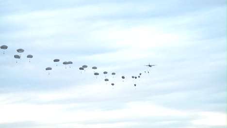 Various-Ground-Views-Of-Paratroopers-Jumping-From-Military-Aircraft