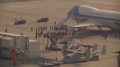 An-Entourage-Awaits-The-President-Of-The-United-States-As-He-Emerges-From-Air-Force-One