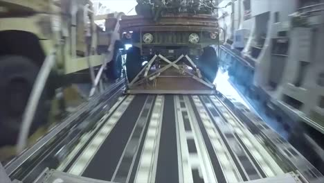 Cargo-Including-Army-Jeeps-Is-Dropped-Via-Parachute-From-A-Us-Air-Force-C130-Globemaster-Aircraft