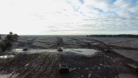 A-Montage-Of-Aerials-Over-Tanks-In-The-Battlefield