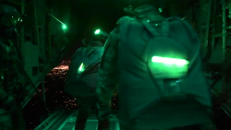 Paratroopers-Jump-From-A-Plane-At-Night-In-Night-Vision