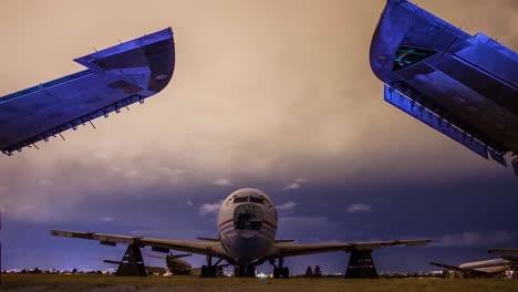 Great-Time-Lapse-Shots-Through-A-Junkyard-Or-Boneyard-Of-Abandoned-Airplanes-At-Night-4
