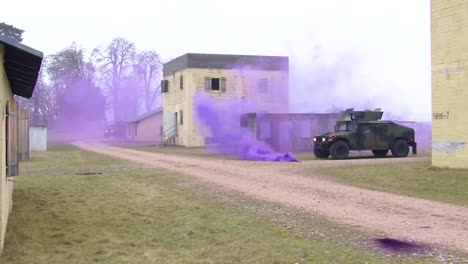 Troops-Practice-Urban-Warfare-And-Hostage-Rescue-In-A-Mock-Village-With-Purple-Teargas