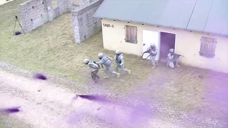 Troops-Practice-Urban-Warfare-And-Hostage-Rescue-In-A-Mock-Village-With-Purple-Teargas-1