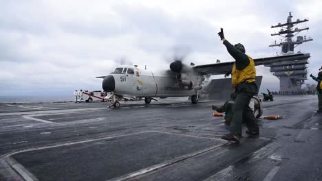 The-Grumann-C2-Greyhound-Takes-Off-From-An-Aircraft-Carrier