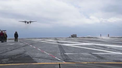 The-Grumann-C2-Greyhound-Lands-On-An-Aircraft-Carrier