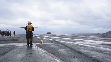 The-Grumann-C2-Greyhound-Lands-On-An-Aircraft-Carrier-1
