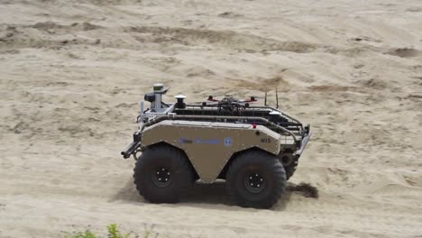 A-Remote-Controlled-Tank-Carries-A-Small-Drone-On-Its-Back-In-A-Military-Maneuver