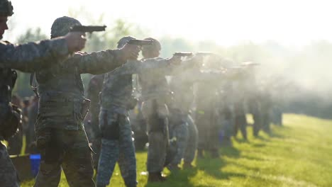 Army-Soldiers-Fire-Pistols-And-Handguns-At-A-Firing-Range