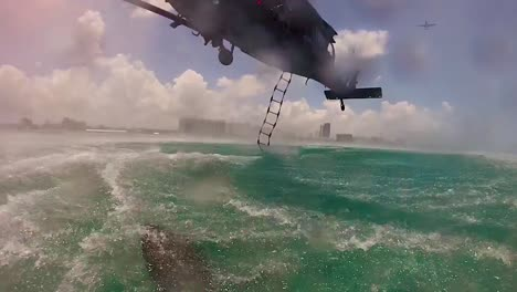 Pov-Go-Pro-Footage-Of-Rescuers-Splashing-Down-From-A-Helicopter-Near-A-Search-And-Rescue-Ocean-Mission