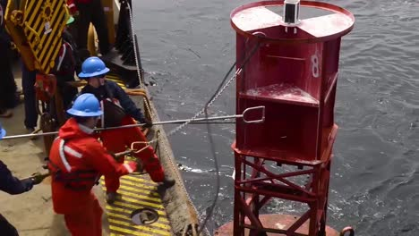 Coast-Guard-Personnel-Maintain-And-Clean-Ocean-Buoys