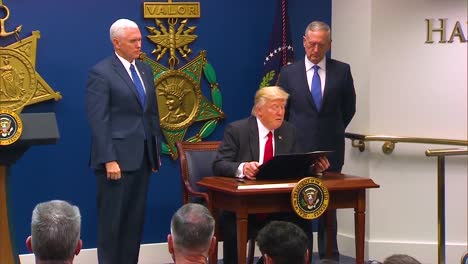 President-Donald-Trump-Signs-A-Bill-To-Protect-The-Us-From-Terrorism-With-Vice-President-Pence-And-Secretary-Of-Defense-Jim-Mattis-Looking-On