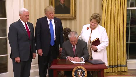 Us-Secretary-Of-State-Rex-Tillerson-At-His-Swearing-In-Ceremony-In-The-White-House-With-Vice-President-Pence-And-President-Trump-Looking-On