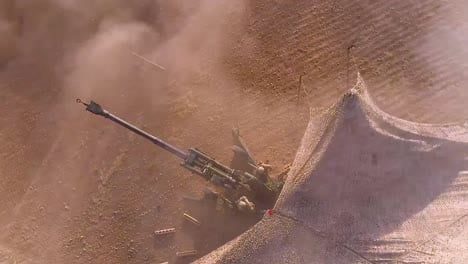 Aerial-Of-Soldiers-Firing-Heavy-Artillery-In-The-Battlefield-2