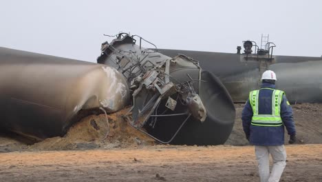 Field-Investigators-From-The-Ntsb-Investigate-An-Oil-Tanker-Train-Wreck-Crash-Near-Graettinger-Iowa-5