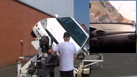 A-Rollover-Police-Car-Is-Demonstrated-For-Us-Soldiers-Stationed-In-Belgium