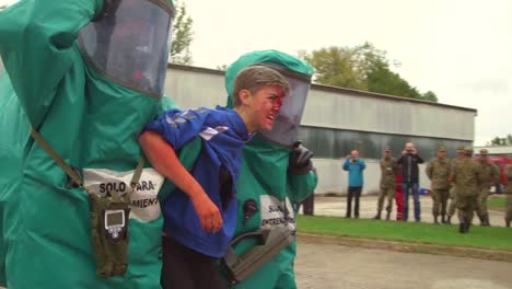 Us-Soldiers-Help-A-Bosnian-Boy-Suffering-From-Simulated-Wounds-As-Part-Of-A-Training-Exercise
