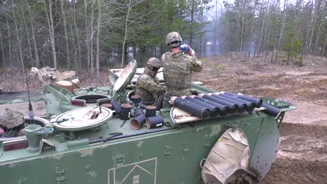American-Soldiers-Load-Ammunition-On-A-Tank-For-A-Test-Firing-In-Latvia