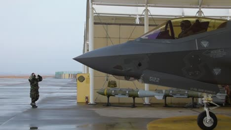 A-Us-Air-Force-F35A-Lightning-Ii-Is-Guided-Out-Of-A-Hangar-At-The-Kunsan-Air-Base-In-South-Korea