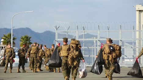 Us-Marines-Are-Transported-By-Bus-And-By-The-Us-Navy-Ship-Guam