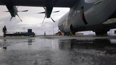 Cargo-Is-Rolled-Past-A-Usaf-Aircraft-At-The-Yokota-Air-Base-In-Japan-For-Operation-Christmas-Drop
