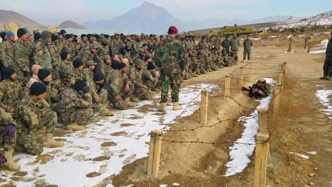 An-Instructor-At-Camp-Commando-Kabul-Shows-Soldiers-How-To-Get-Past-A-Lowwire-Obstacle