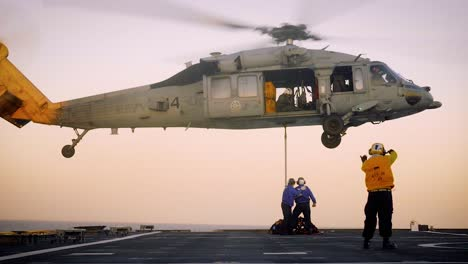 A-Us-Navy-Helicopter-Hovers-Over-The-Landing-Area-Of-The-Uss-Gabrielle-Giffords