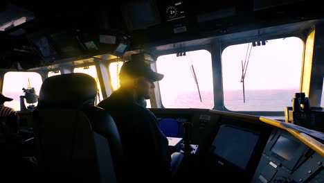 Us-Navy-Sailors-Check-Monitors-Above-Deck-On-The-Uss-Gabrielle-Giffords