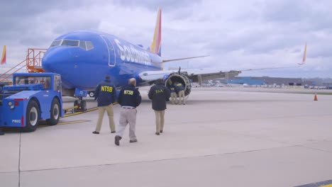 Ntsb-Inspectors-Look-At-An-Aircraft-Engine-Which-Expoded-In-Midair-During-A-Southwest-Airlines-Flight