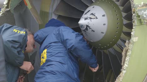 Ntsb-Inspectors-Look-At-An-Aircraft-Engine-Which-Expoded-In-Midair-During-A-Southwest-Airlines-Flight-1
