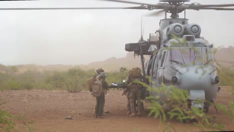 Us-Airmen-Load-A-Stretcher-Onto-A-Helicopter-As-Part-Of-The-Angel-Thunder-Training-Exercise