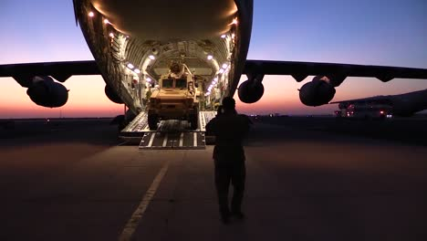 A-Military-Vehicle-Is-Driven-Onto-A-C17-Cargo-Carrier