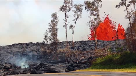 Lava-Flows-Across-A-Road-In-Hawaii-During-The-2018-Kilauea-Volcano-Eruption