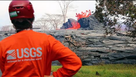 Researchers-From-The-Usgs-Watch-As-Lava-Flows-Across-A-Road-In-Hawaii-During-The-2018-Kilauea-Volcano-Eruption