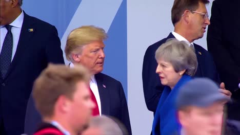 Us-President-Donald-Trump-Poses-With-British-Prime-Minister-Theresa-May-At-The-Nato-Summit-In-Brussels-Belgium
