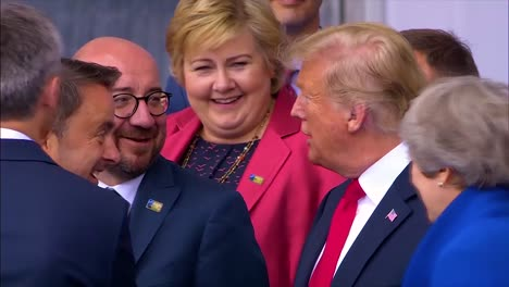 Us-President-Donald-Trump-Jokes-With-Belgian-Pm-Charles-Michel-And-Luxembourg-Xavier-Bettel-At-The-Nato-Summit-In-Brussels-Belgium