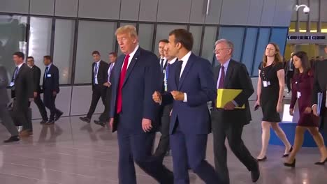 Us-President-Donald-Trump-Moves-Through-A-Crowd-At-The-Nato-Summit-Conversing-With-French-President-Emmanuel-Macron-1