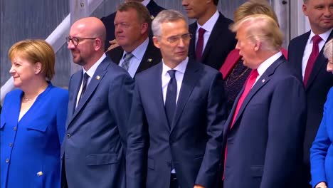 Us-President-Donald-Trump-Talks-With-Jens-Stoltenberg-Angela-Merkel-And-At-The-Nato-Summit-In-Brussels-Belgium