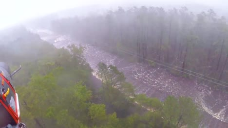 A-Search-And-Rescue-Team-Rescues-A-Man-Trapped-In-Flood-Waters-In-His-Truck-During-Hurricane-Florence-1