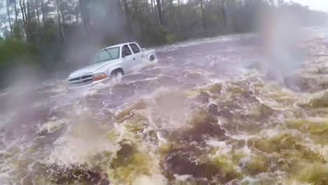 A-Search-And-Rescue-Team-Rescues-A-Man-Trapped-In-Flood-Waters-In-His-Truck-During-Hurricane-Florence-3