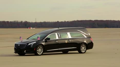 A-Hearse-Transporting-The-Body-Of-George-H-W-Bush-Arrives-At-Air-Force-One-To-Transport-The-Former-President-To-His-Final-Resting-Place-During-A-State-Funeral