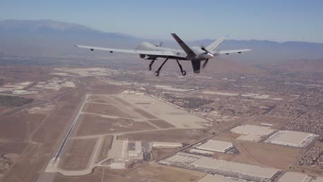 An-Unmanned-Aerial-Drone-Flies-Above-The-Desert-In-This-Military-Mission-Aerial
