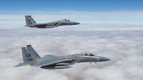 American-F15-Fighter-Jets-Fly-In-Formation-High-Above-The-Clouds
