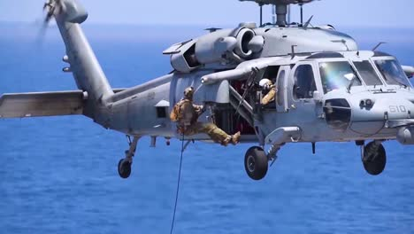 Navy-Fastrope-Exercise-Features-Soldiers-Rapelling-From-A-Hovering-Helicopter-On-The-Flight-Deck-Aboard-Uss-Harry-S-Truman-Aircraft-Carrier