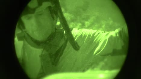 A-Military-Search-And-Rescue-Commando-Rescues-A-Civilian-Woman-From-An-Emergency-Via-Rope-And-Helicopter-In-Night-Vision
